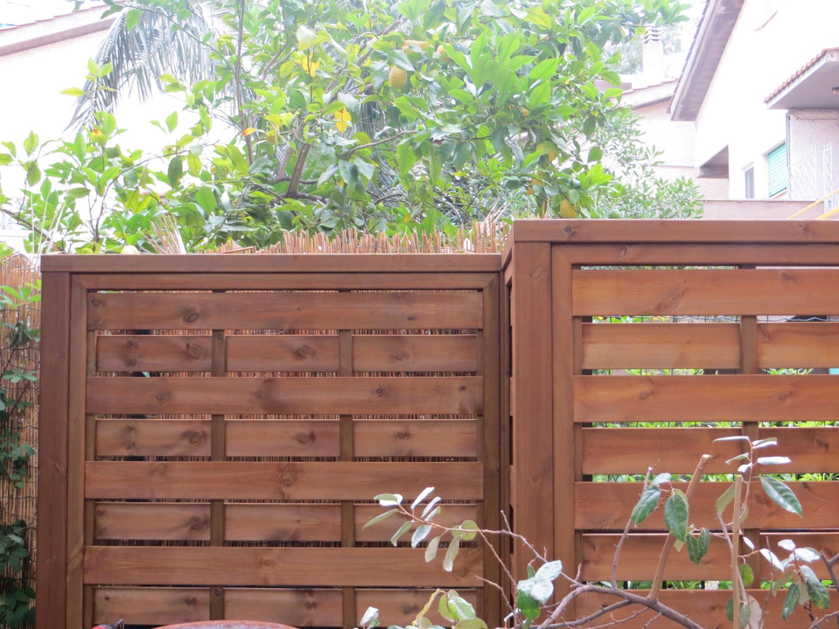 frangivento in legno roma monteverde