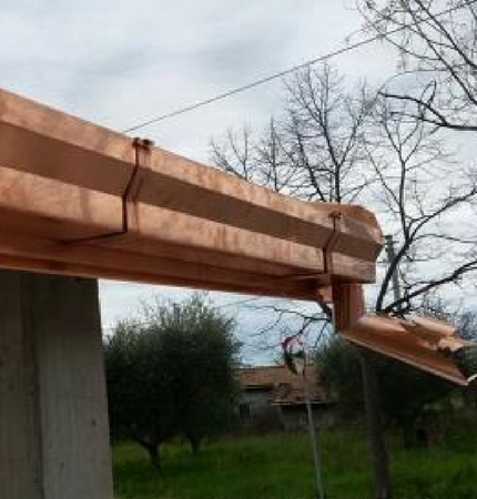 Rivestimento tettoia con abbellimenti rame
