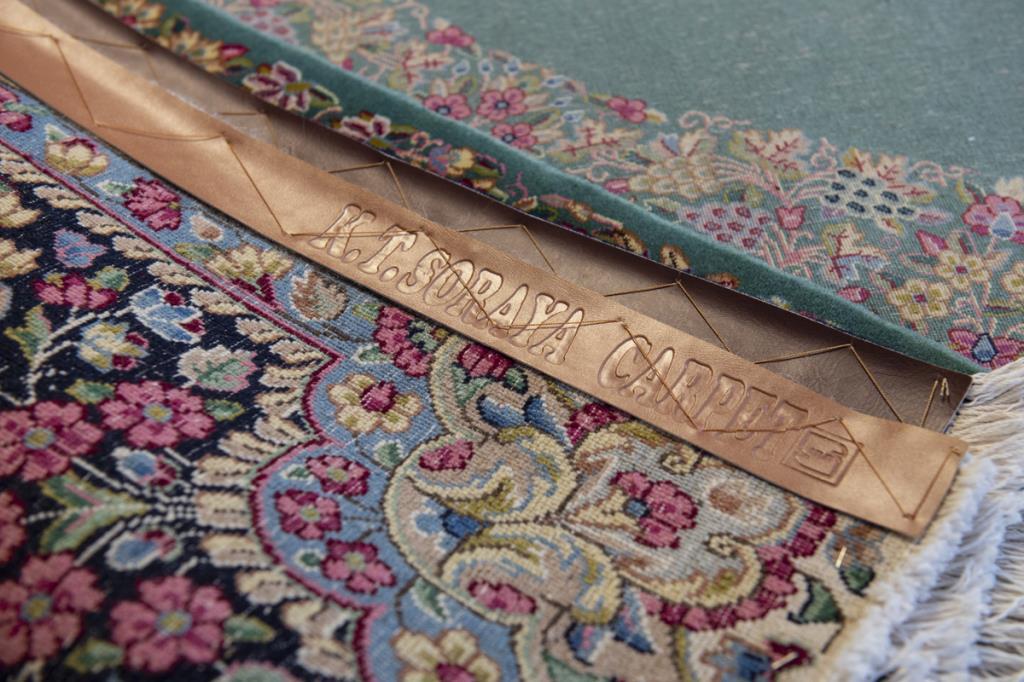 vendita tappeti tessuti ricamati