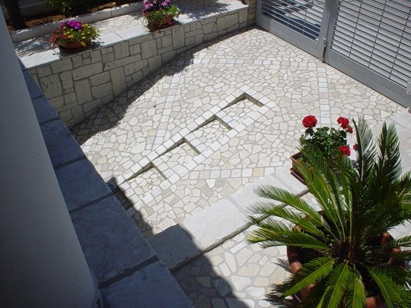 Pavimentazione esterna porfido lavorazioni e realizzazioni in marmo Manduria Taranto Emme Marmi Srl