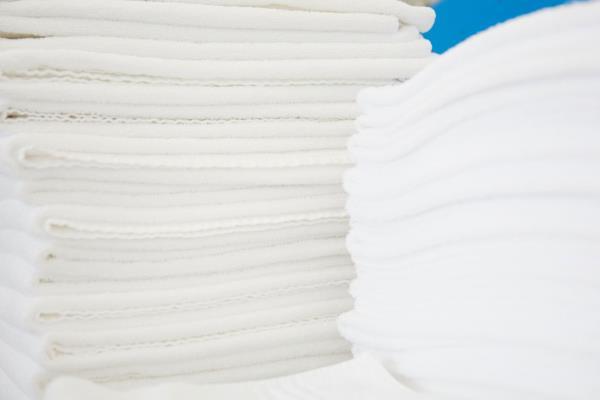 Piegatura lenzuola per strutture ricettive