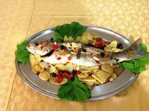 Fish in white wine with potatoes olives and cherry tomatoes