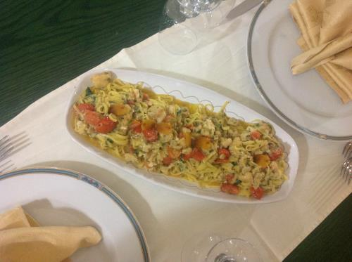 Catalan tagliolini with monkfish, prawns, bottarga and cherry tomatoes