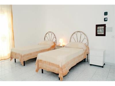 camera da letto appartamento trastevere Roma