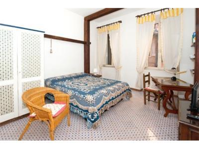 camera da letto monolocale Trastevere Roma centro