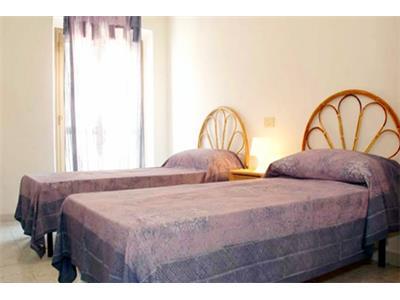 bilocale camera da letto trastevere roma