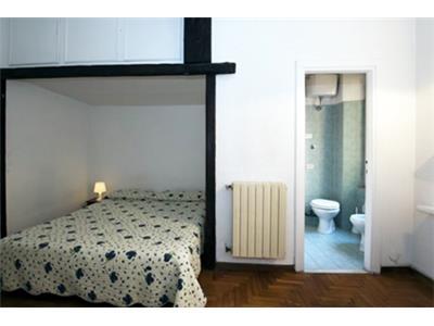 camera da letto matrimoniale bilocale trastevere Roma