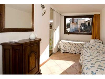 Camera da letto attico bilocale trastevere