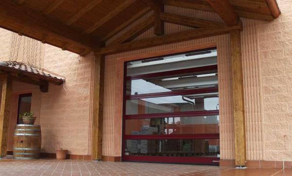fornitura e posa portoni sezionali commerciali con finestre | Sacile (PN) | Fontanafredda (VE)